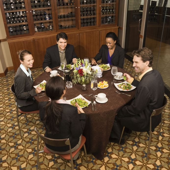 2616111 - high angle of group of businesspeople in restaurant dining.
